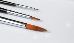 paint brushes lined up on a white background blog image